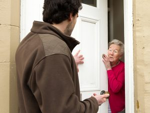 woman opening door to pushy man